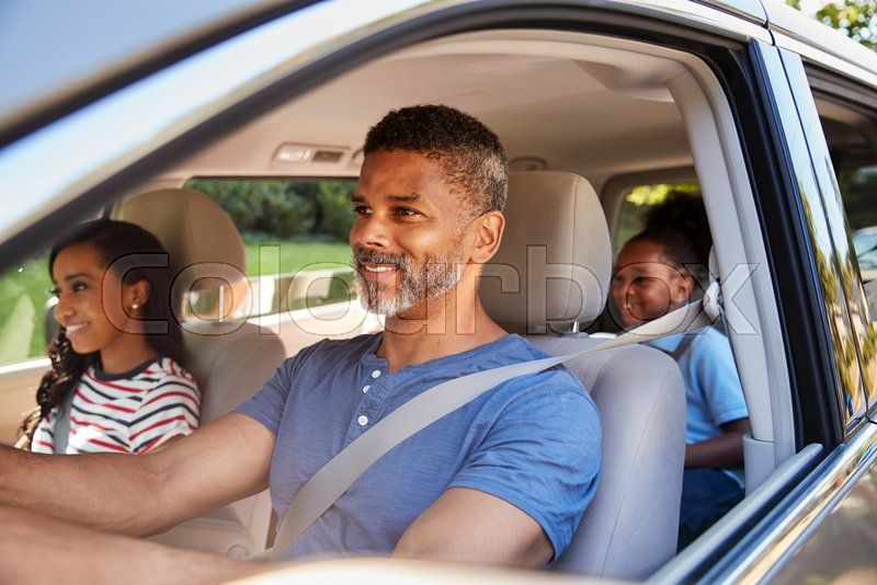 Family In Car Going On Road Trip, stock photo