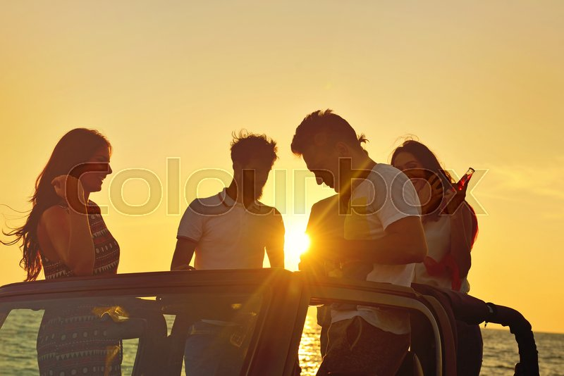 Group of happy friends making party in car - Young people having fun drinking champagne and taking photo selfie during their road trip - Friendship, party, youth addiction lifestyle concept, stock photo