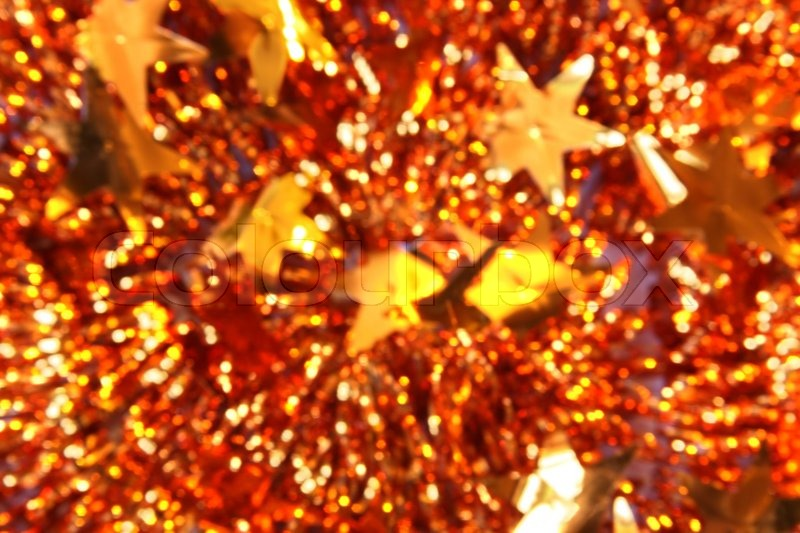 Defocused Christmas background of tinsel with stars, stock photo