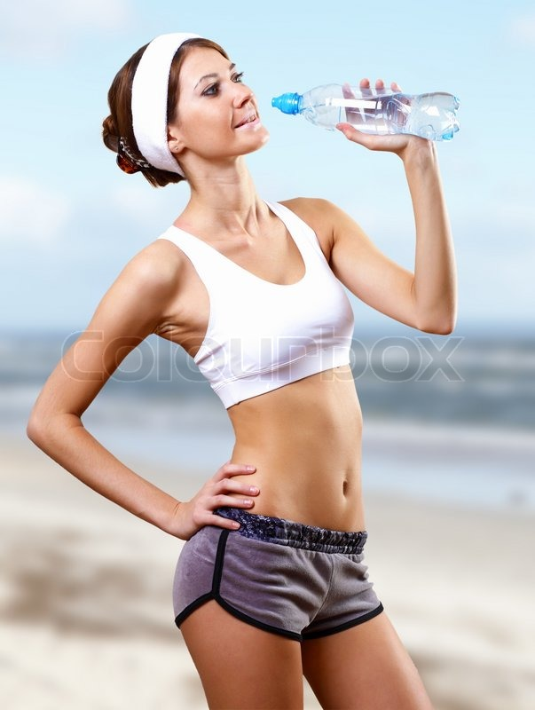 Young pretty woman in sport wear doing sport, stock photo