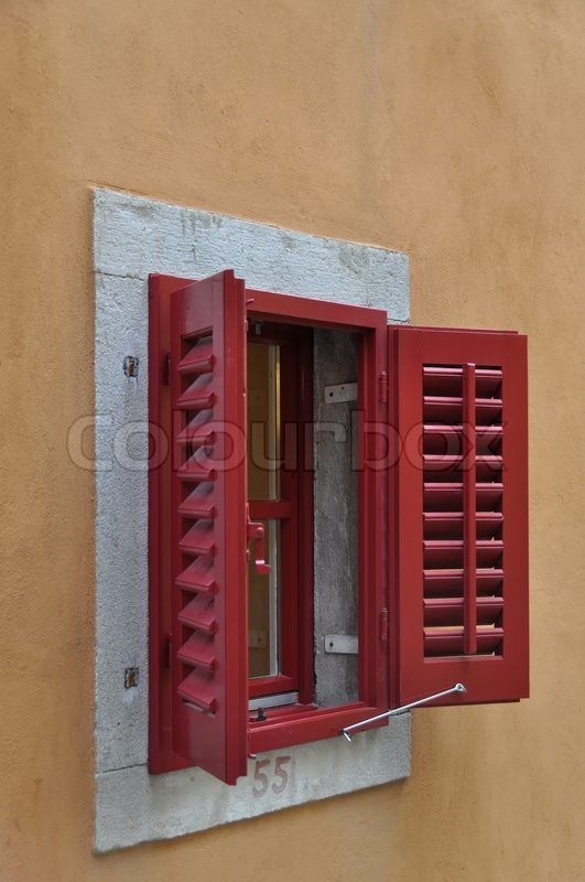 Red Window Shutters Opened On A Bright Frame Above A