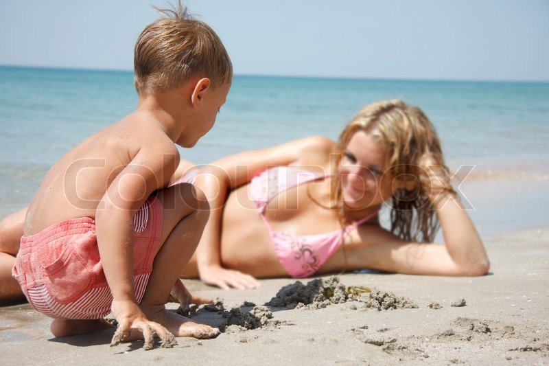 Mother And Son Playing On Beach Stock Photo Colourbox
