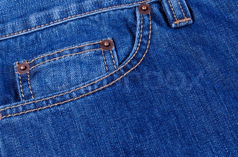 The delayed pocket of dark blue jeans a background | Stock Photo | Colourbox