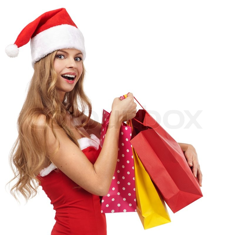Portrait of a Christmas woman in santa costume holding a shopping ...