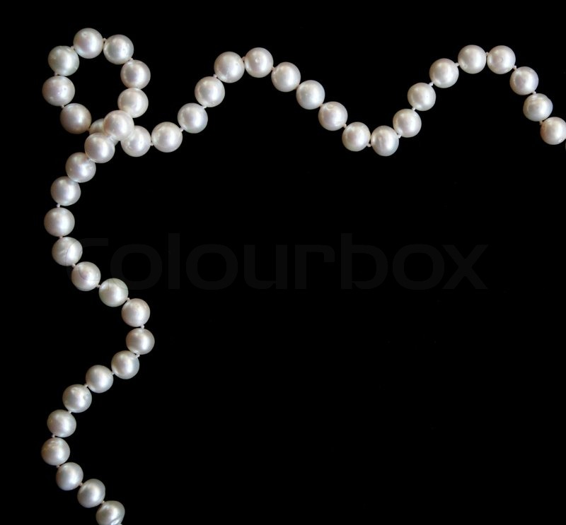 White pearls on the black silk as background | Stock Photo ...