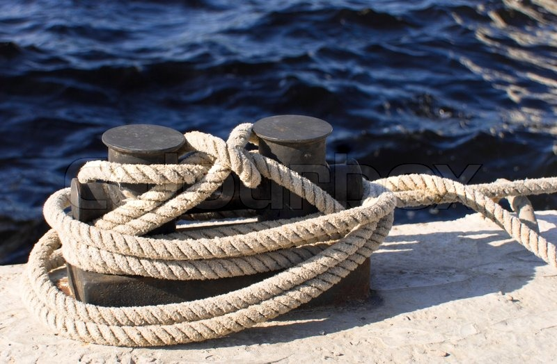 Boats And Docks To Which Ropes Are Tied Stock Photo