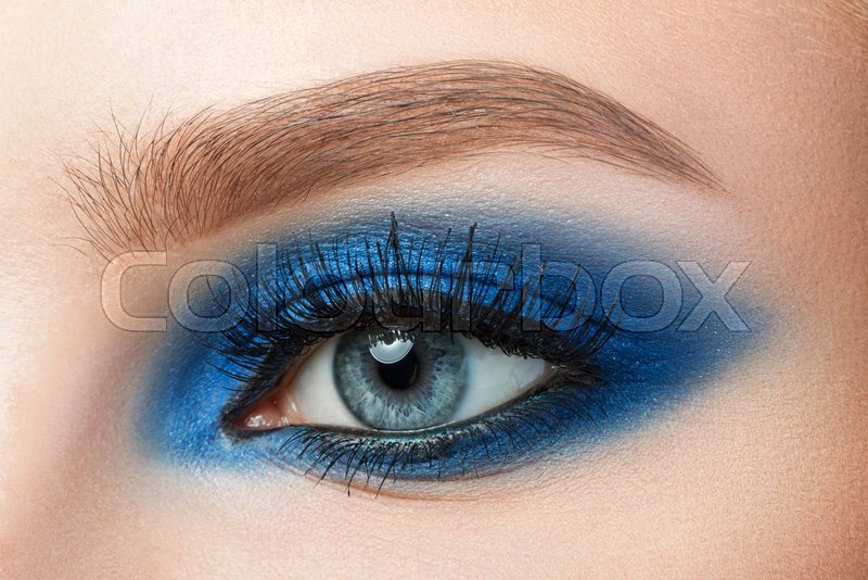 Close Up Of Woman Blue Eye With Stock Photo Colourbox