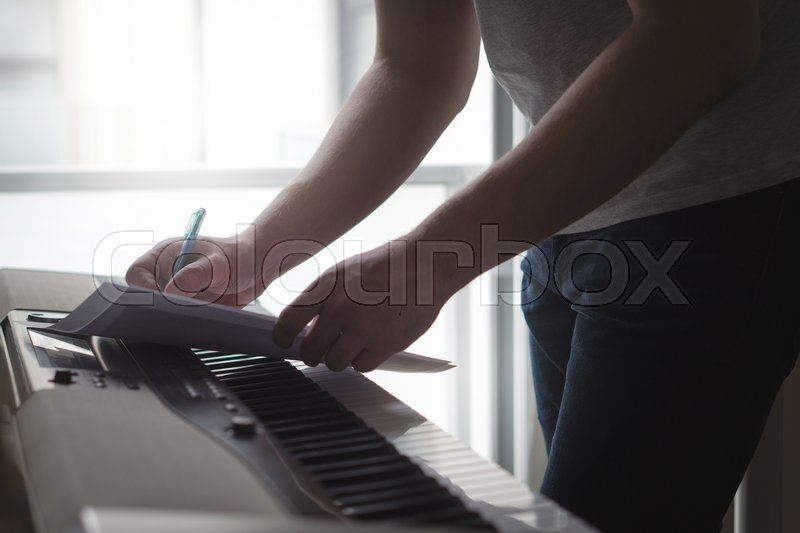 Composer and songwriter writing notes     | Stock image | Colourbox