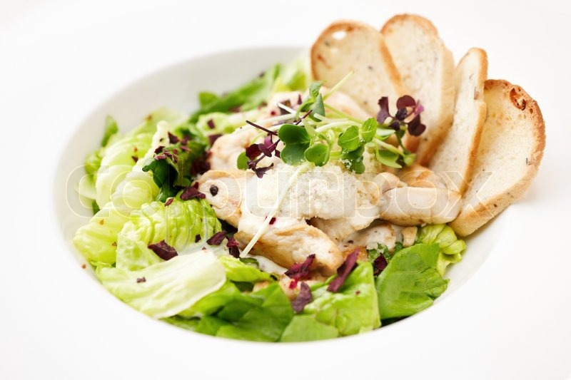Classic Caesar Salad With Chicken On A Plate Stock Photo