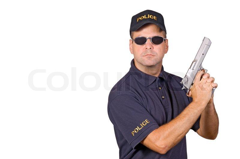 Policeman Holding Gun Stock Photo Colourbox