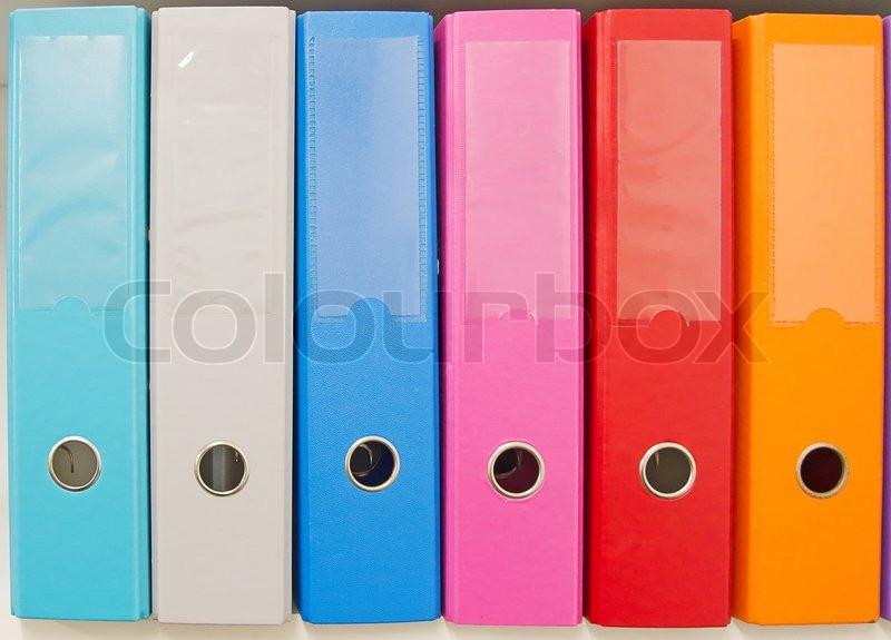 Colorful office folders on the bookshelf | Stock Photo | Colourbox