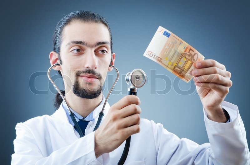 dollar stock photos doctor with money in studio stock photo colourbox 2947