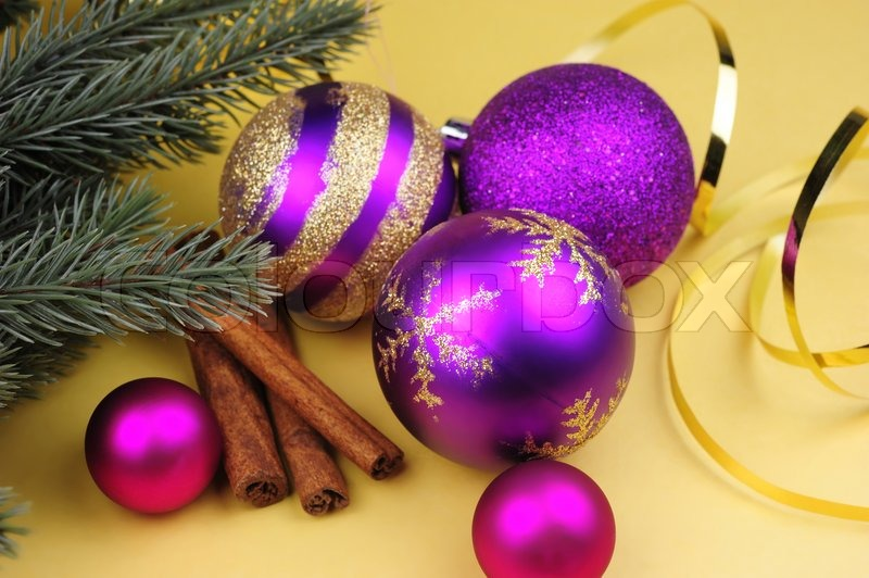 Purple Christmas Balls Of Various Sizes Cinnamon Sticks Twig