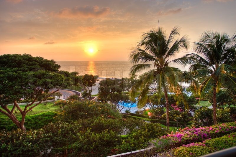 Charmant Sunset At Tropical Resort With View Of Ocean And Lush Garden | Stock Photo  | Colourbox