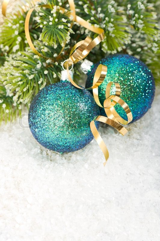 blue christmas bauble with christmas tree branch in snow decoration stock photo colourbox - Teal Green Christmas Decorations