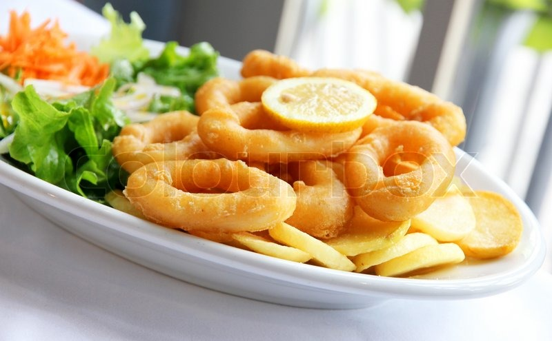 3139706-deep-batter-fried-squid-rings-calamari-with-green-salad-on ...