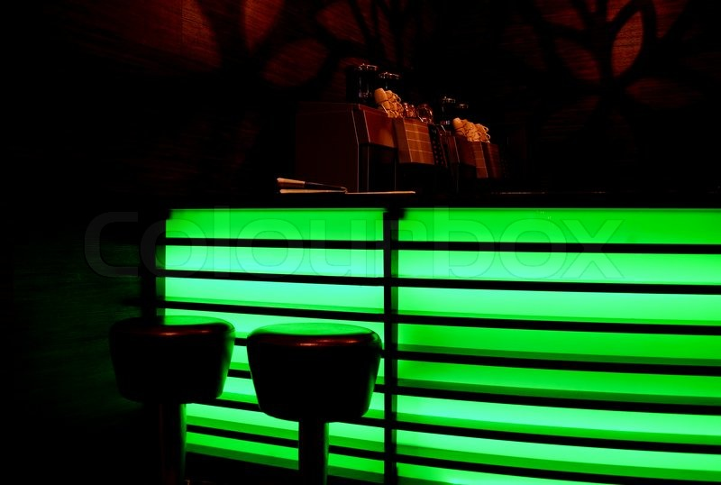 Bar With Green Neon Lights Stock Photo Colourbox