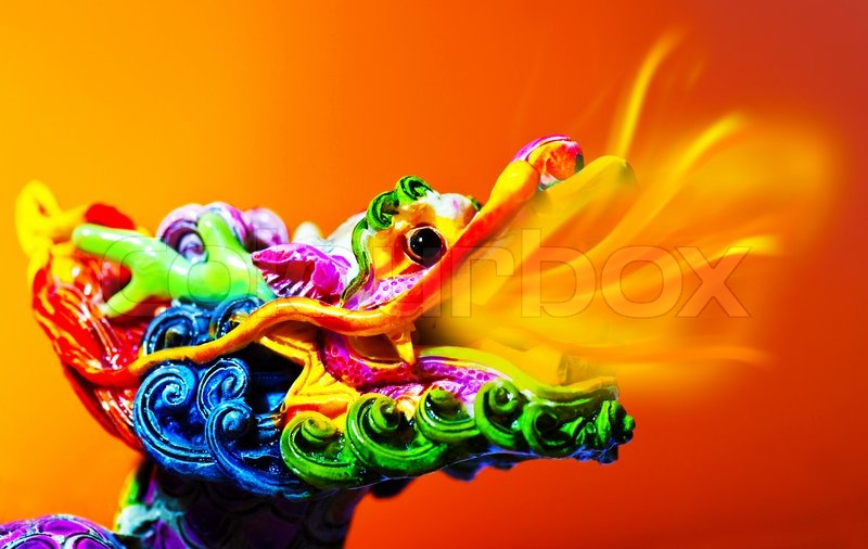 colorful dragon head with tongue of fire flame