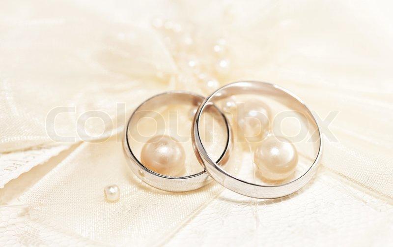Pair of golden wedding rings over invitation card for Pictures of wedding rings for invitations