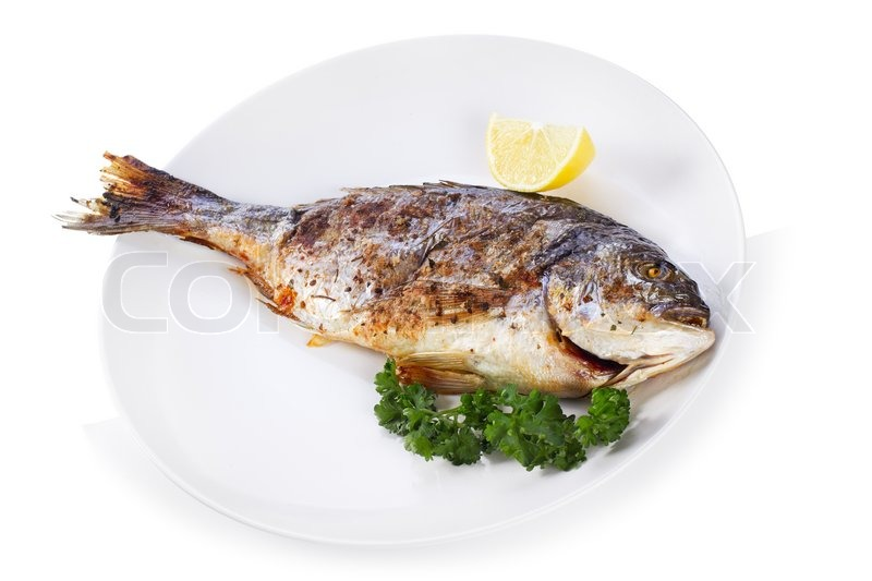 Grilled fish with lemon and parsley on white background ...
