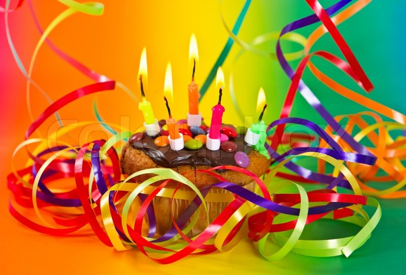 Birthday Cake With Burning Candles And Colorful Decoration Stock