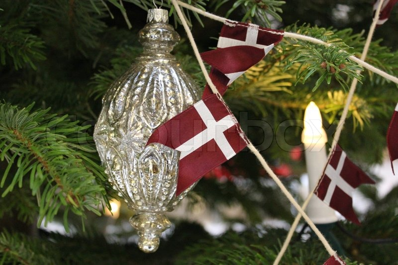 Stock image of 'Christmas tree decorations on branches - silver and flag'