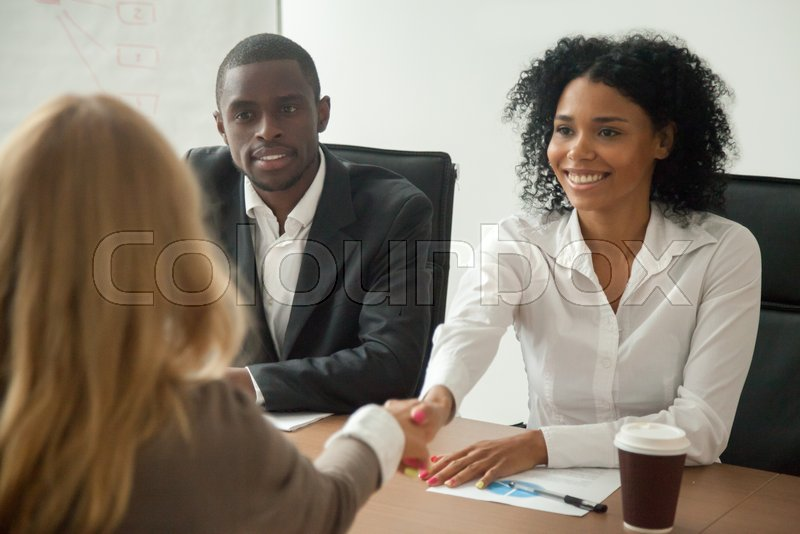 african american hr team welcoming female applicant at job interview  diverse businesswomen