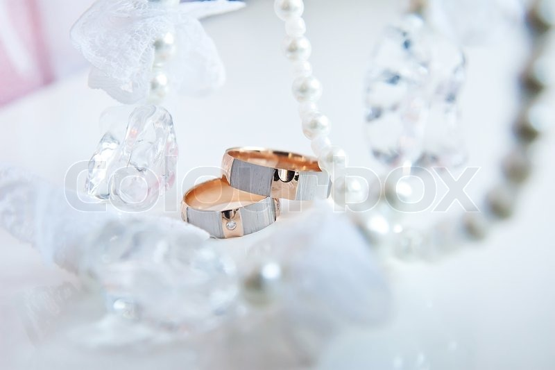 Two Wedding Rings And Necklaces In The Stock Photo Colourbox