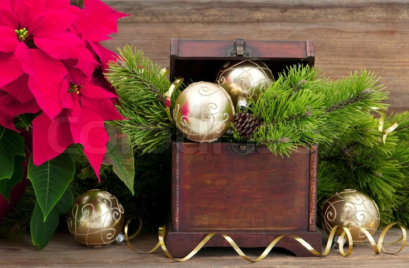 christmas tree branch with golden decoration vintage wooden box and pink christmas flower poinsettia stock photo colourbox - Wooden Box Christmas Decorations
