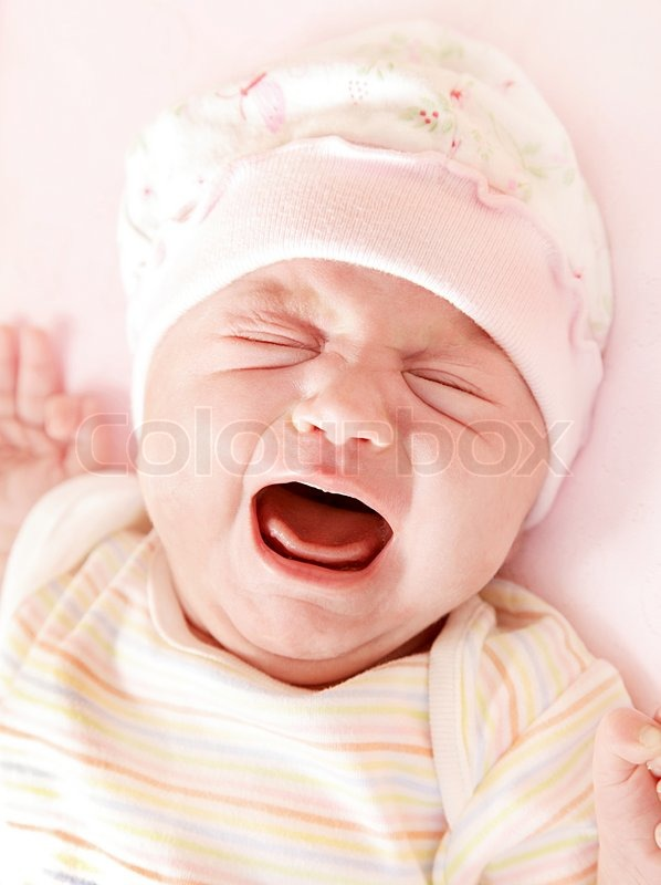 Closeup Portrait Of Cute Little Baby Girl Crying In Pink