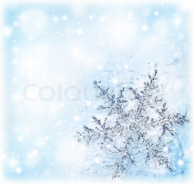 Christmas Holiday Background With Big Beautiful Snowflake Tree Ornament And Decoration Blue Card Made Of Abstract Blur Bokeh Magic Lights