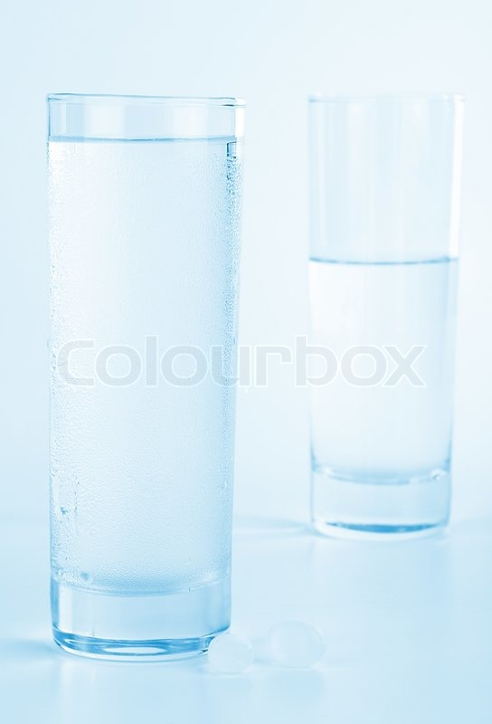 Glass of fresh water with medical pills, studio isolated, health care concept, stock photo