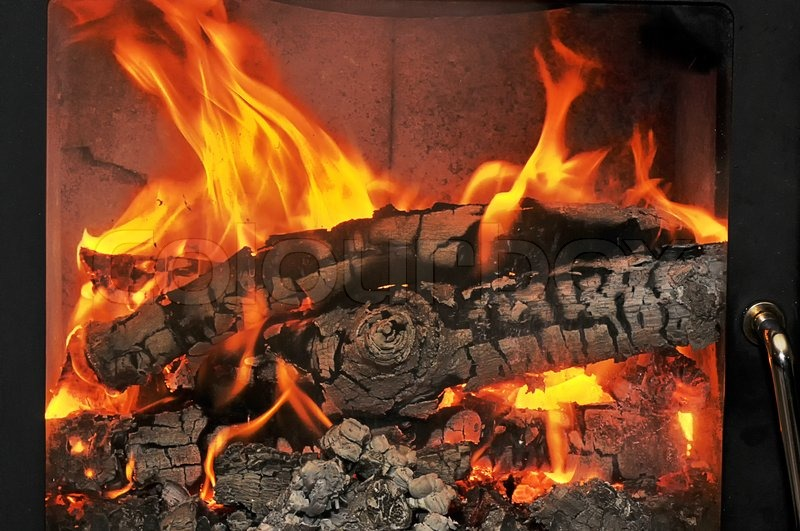 Burning Wood In The Fireplace And The Flames Stock Photo