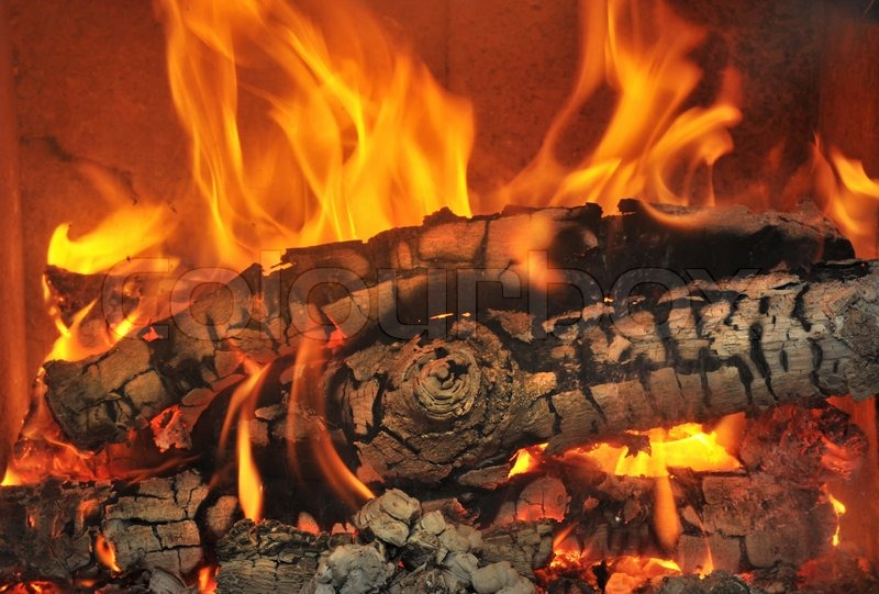 Burning wood in the fireplace and the flames | Stock Photo ...