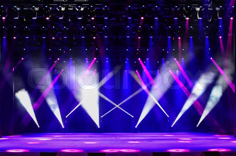 Illuminated Empty Concert Stage With Haze And Rays Of Red Purple Blue Light Background For Music Show