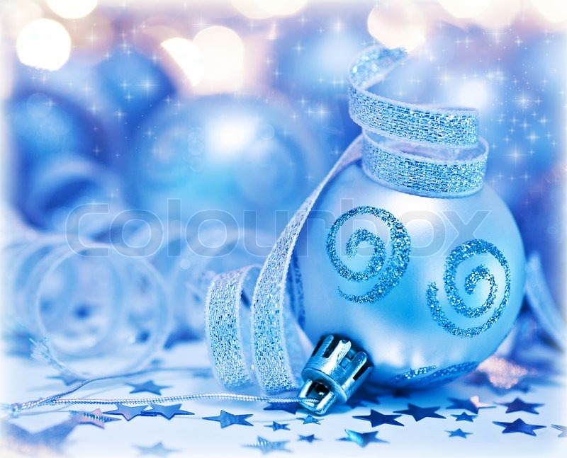 Christmas Tree Ornament Bauble Decoration Over Bokeh Abstract Background Lights Beautiful Silver Blue Toy With Ribbon Home Decor For Winter Holidays