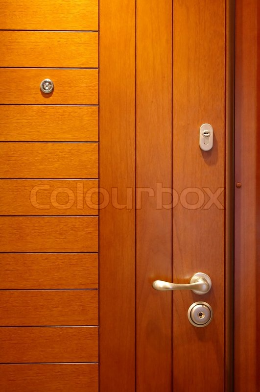 & Wooden door with the lock and a spy hole | Stock Photo | Colourbox