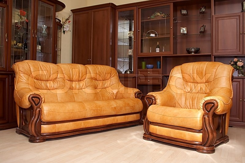 Yellow Leather Sofa And Armchair On A Parquet Stock