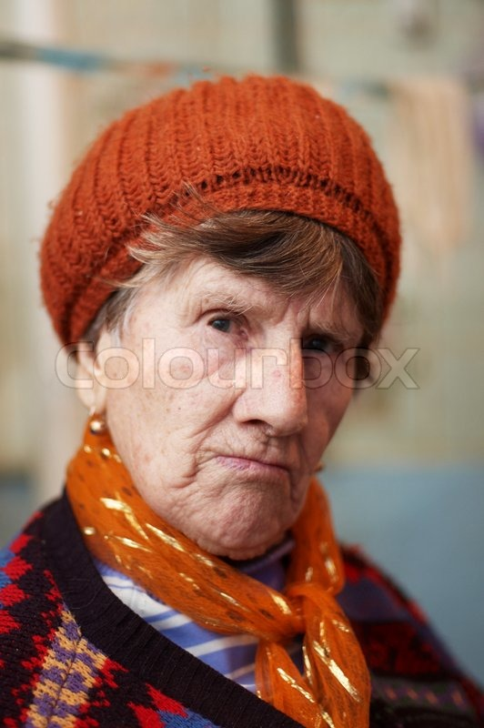 Portrait of old woman in red beret  8b8b6af844b