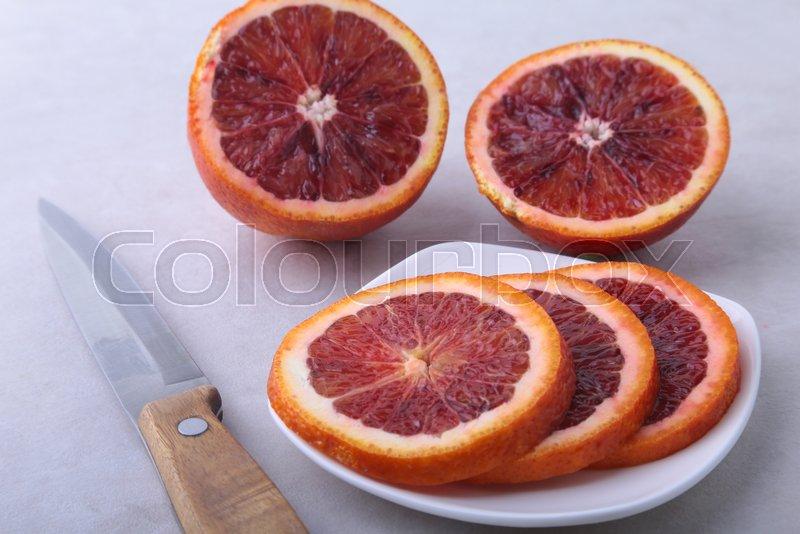 Orange fruit. Orange and lemon slice on white plate. Top view, stock photo