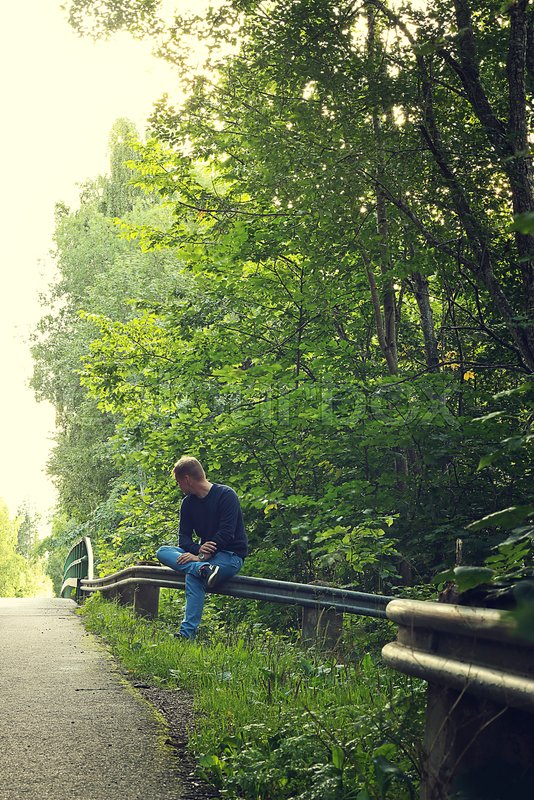 Person waiting next to the road, stock photo