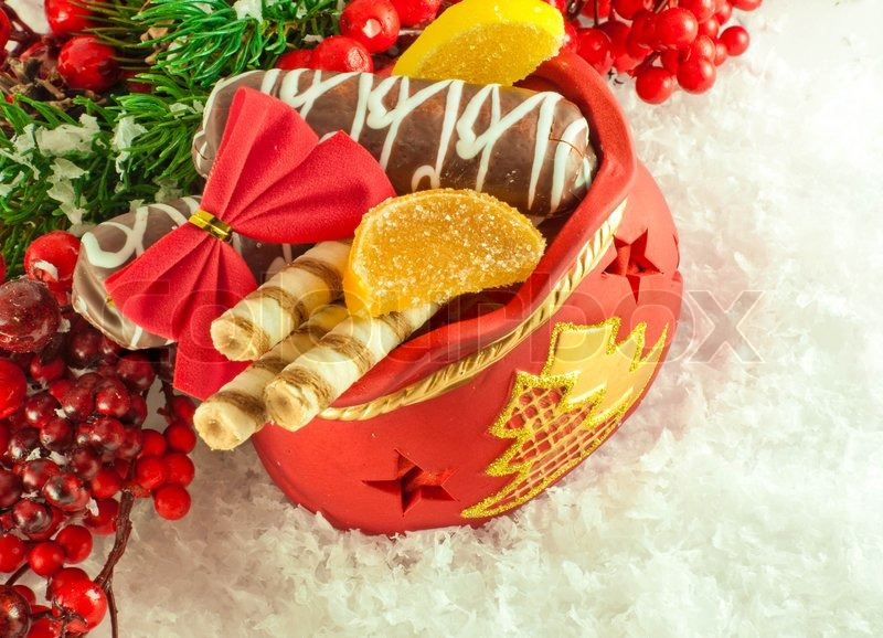 Stock image of christmas bag with gifts cookies and fruit candy a