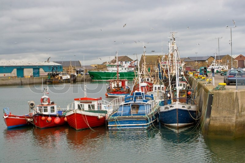 Fishing Boats Docked In The Howth Harbor Ireland Stock