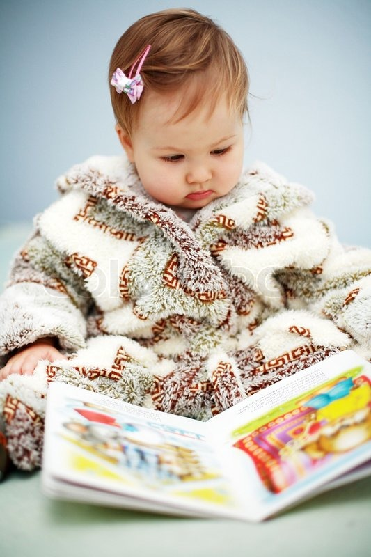 Portrait Of Cute Baby Reading A Picture Stock Image