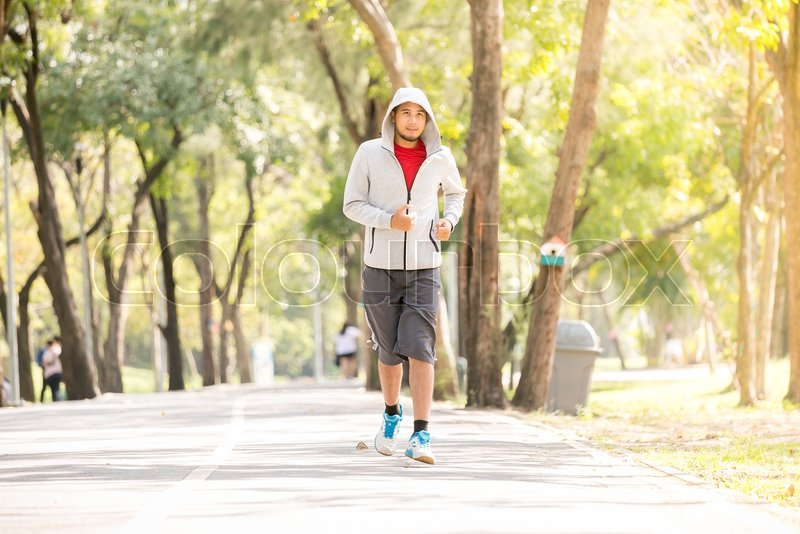 Athletic Happy Young Asian Man Running Stock Image