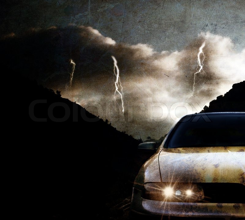 Stock image of 'Grungy car at night with thunderstorm'