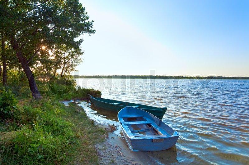 Old wooden fishing boats near the summer lake shore Svityaz, Ukraine | Stock Photo | Colourbox