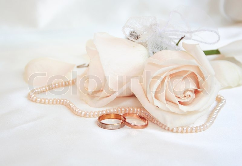 Wedding Rings And Roses As Wedding Background Stock