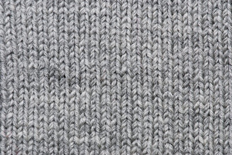 Grey Knitting Background Of Handmade Woolen Pattern