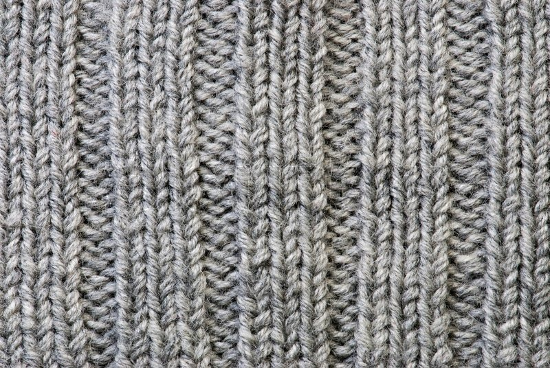 Woolen Knitting Patterns : Grey knitting background of handmade woolen pattern Stock Photo Colourbox